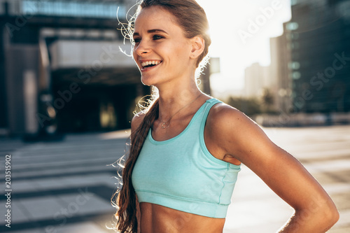 Fototapeta  Happy female athlete in morning