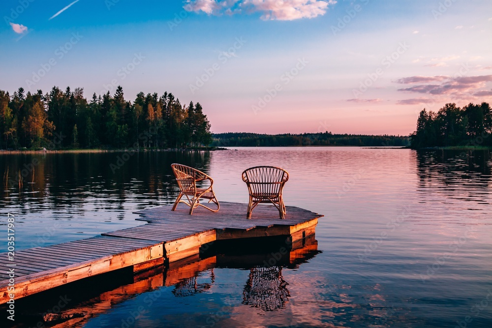 Fototapety, obrazy: Two wooden chairs on a wood pier overlooking a lake at sunset