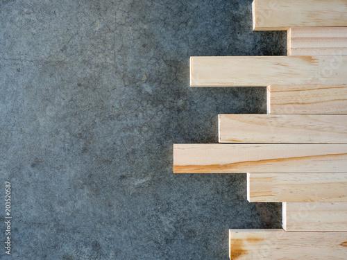Fototapeta Concrete background, construction pattern and wooden board. obraz na płótnie