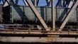 Freight train rides the steel bridge