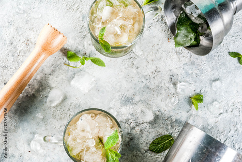 Valokuva Cold summer beverage, mint julep cocktail drink, grey stone background copy spac
