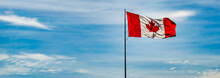 Panorama Of Canada Flag Against A Blue Sky