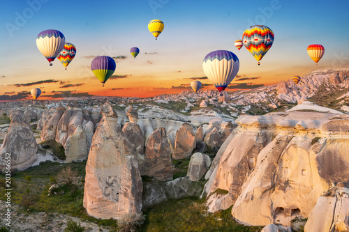 Aluminium Prints Balloon Hot air balloons at sunset over the cave town, Cappadocia, Turkey