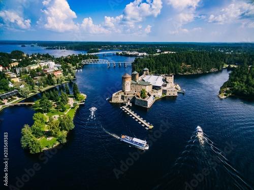 Foto auf Gartenposter Schwarz Aerial view of olavinlinna medieval castle in Savonlinna, Finland