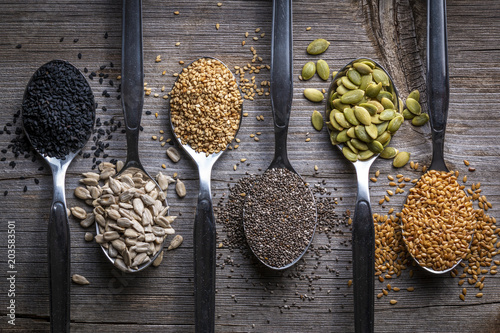 Spoons with assortment of seeds Fototapeta