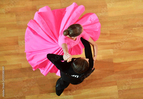Dancers performing in a competition of ballroom dancing Wallpaper Mural