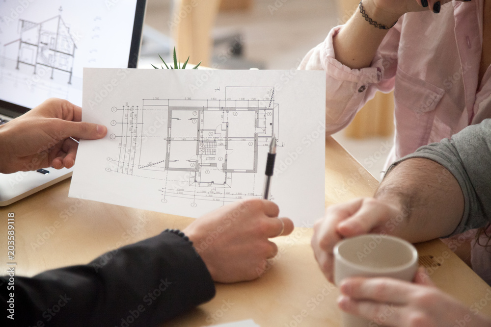 Fototapety, obrazy: Architect or interior designer showing new apartment plan to couple at meeting, realtor consulting customers making real estate offer, mortgage loan investment and construction concept, close up view