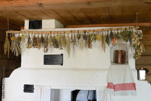 Photo  Different types of herbs dried on a rope inside house