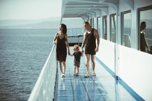Mother And Father With Their Children Travel On Ship.