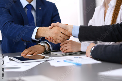 Papiers peints Ecole de Danse Business people shaking hands, finishing up a papers signing. Meeting, contract and lawyer consulting concept