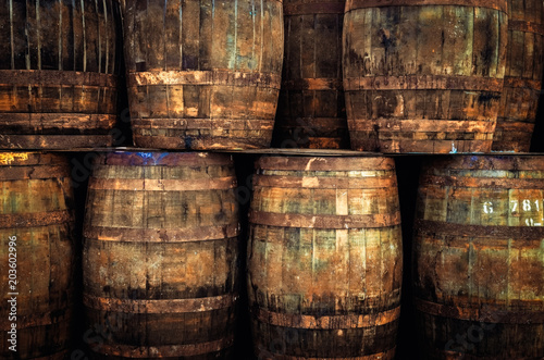Detail of stacked old wooden whisky barrels