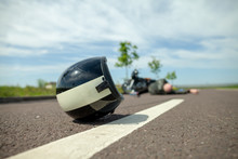 Biker Helmet Lies On Street Ne...