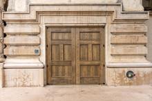 Facade Of Old Building With Wooden Door