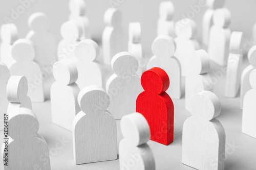Obraz Concept is the choice of  special employee of the leader. Concept how to choose sexual partner for love from a similar crowd. Many white men and one red - fototapety do salonu