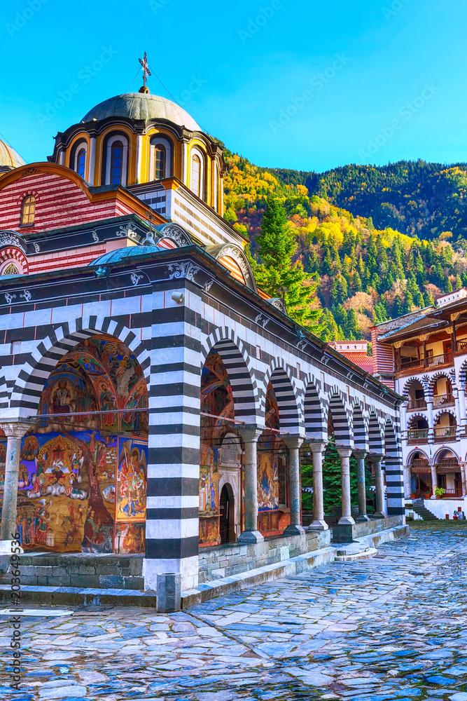 Fototapety, obrazy: Bulgaria, Rila monastery view with autumn mountain trees at background
