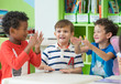 canvas print picture Group of diversity kids boy sit on table and playing together in preschool library,Kindergarten school education concept
