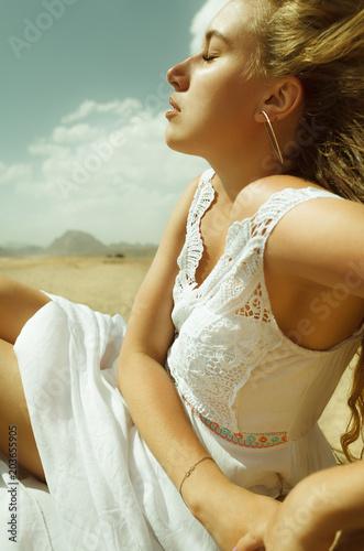 Vászonkép  sexy blond pretty girl blinded by sun in desert of Egypt