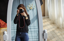 The Girl Takes Pictures In The Mirror On A Professional Camera