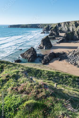 Spoed Foto op Canvas Khaki Stunning dusk sunset landscape image of Bedruthan Steps on West Cornwall coast in England