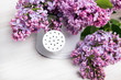 Lilac flowers on white wooden background, copy space