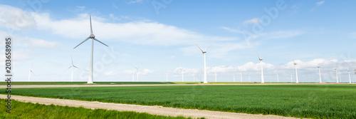 Spoed Foto op Canvas Blauwe hemel Parnoma with Wind turbines along the dikes in the Neterlands