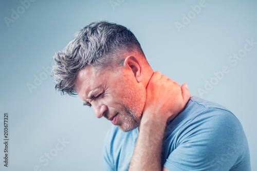 Canvas Print Young man suffering from neck pain. Headache pain.
