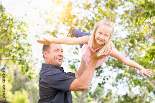 Photo  Young Caucasian Father and Daughter Having Fun At The Park