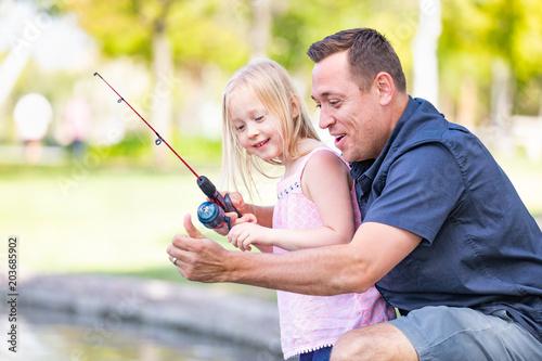 Young Caucasian Father and Daughter Having Fun Fishing At The Lake Wallpaper Mural