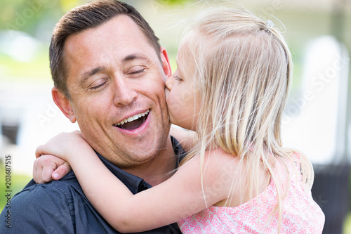 Young Caucasian Father and Daughter Having Fun At The Park Canvas Print