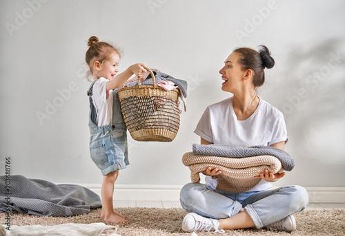 Fotografie, Obraz  family doing laundry at home