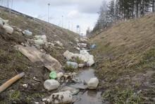 Trash In A Roadside Ditch