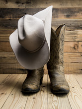 Cowboy Boot And Western Hat On...