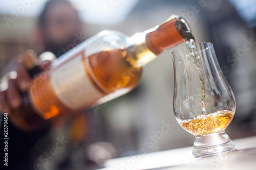 Pouring whisky in a glass