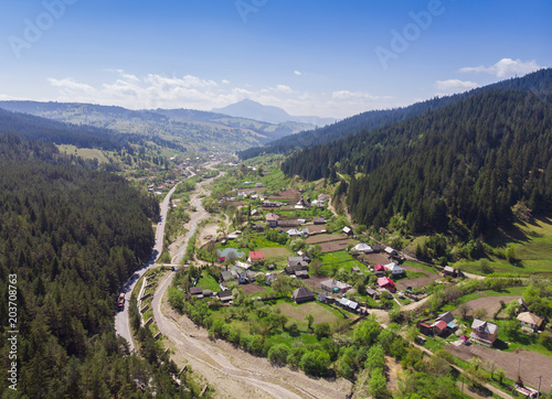 Fotobehang Lavendel aerial view of village and forest, panorama from Poiana Teiului. Romania