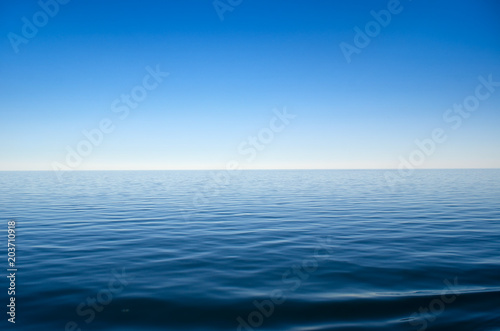 Panorama of sea waves against the blue sky
