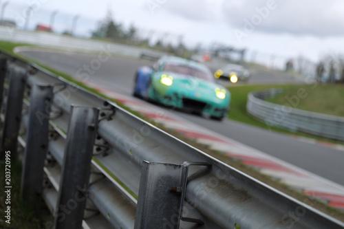 Fotografía  Racing car and crash barrier - Stockphoto