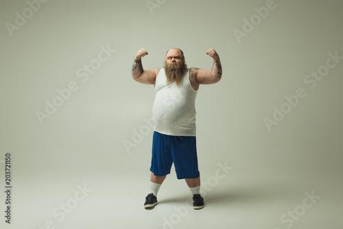 Fotografie, Obraz  Man showing his muscles