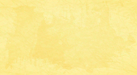 Yellow scratched background with spots of paint.