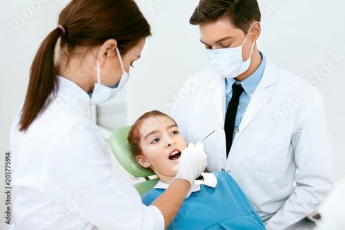 Fotografie, Obraz  Oral Health Care. Dentist Doctors Making Examination Procedure
