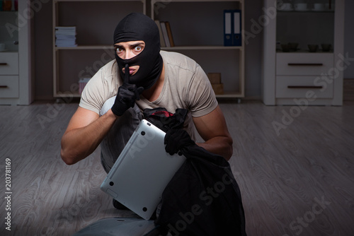 Cuadros en Lienzo  Burglar wearing balaclava mask at crime scene