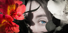 Black And White Portrait Of Young Girl Among Pink Flowers And Detail Of Her Blue Eye
