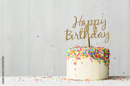 Photo  Birthday cake with gold banner