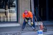 Workers repair the road.