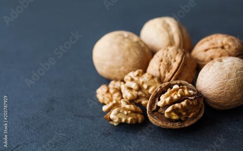 Cuadros en Lienzo Beautiful ripe walnut harvest on black stone background