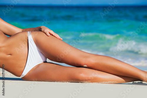 Obraz Tanned woman in bikini - fototapety do salonu