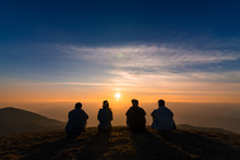 Silhouette Of Friends  Sitting Together Watching Sunset For Business Successful And Team Work Concept