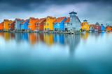 Fototapeta Tęcza - Fantastic colorful buildings on water, Groningen, Netherlands, Europe