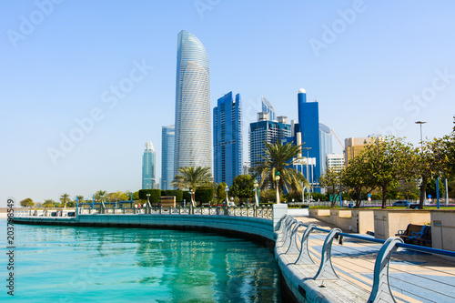 Tuinposter Abu Dhabi Modern buildings of downtown Abu Dhabi view from the walking area by the seaside