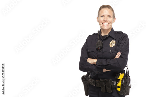 Female police officer posing with arms crossed Fotobehang