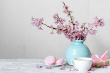 Pink Cherry Blossom Flower Bouquet With Coffee Cup, Macaroons And Gift Box In Blue Vintage Vase